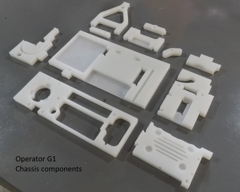 The eleven pieces of CNC machined HDPE that create the chassis...  Operator G1 OP Chassis Comp 01