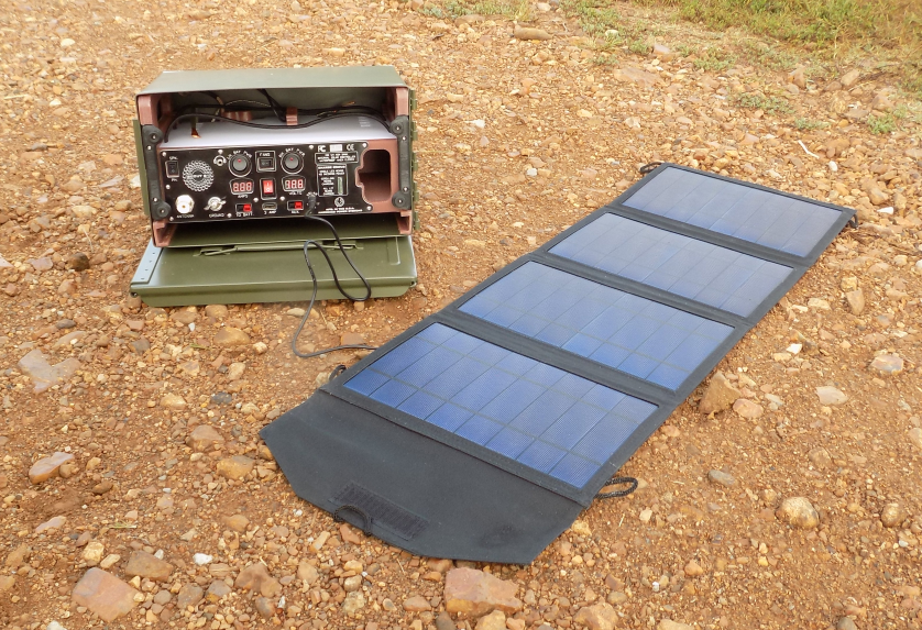 Scout shown with our 27 watt solar panel. When folded, the panel fits inside the Scout.  Scout G1 SG1 SP iso 01