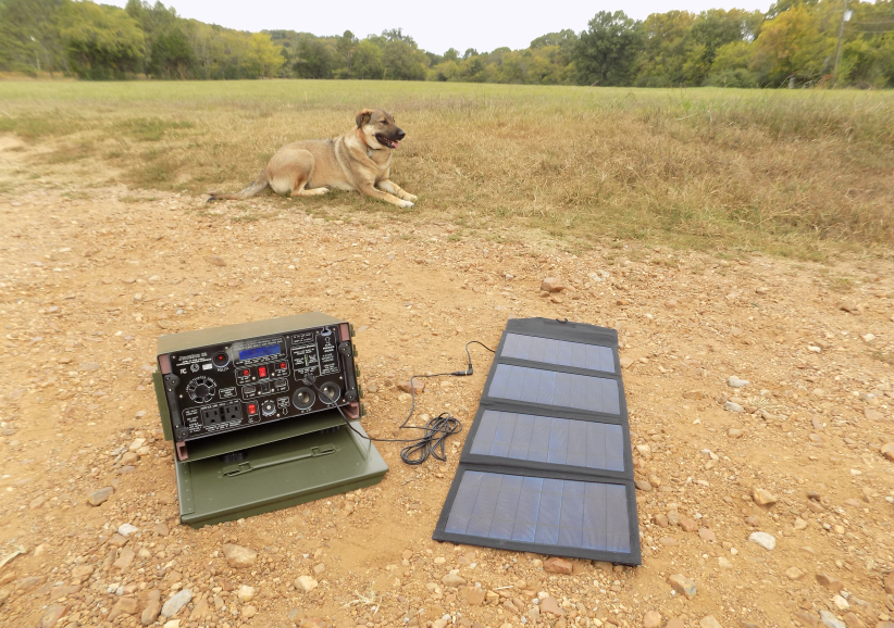 JuiceBox G2 portable Solar Generator, with 27 watt folding solar panel. Dog not included.  JuiceBox G2 JBG2 iso sp 01 small